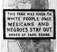 Sign: This park was given for white people only. Mexicans and Negroes Stay Out. Order of Park Board.